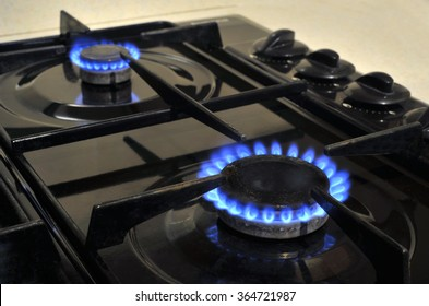 Gas cooker hob burner rings and flames.