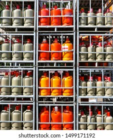 Gas cylinders. Storage in lattice boxes, ready for transport.