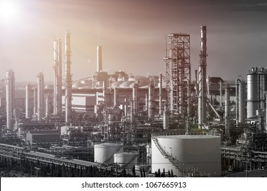 Gas distillation tower and smoke stack Petroleum industrial plant, Manufacturing of petrochemical industry plant with black and white on sky sunlight background, Downstream of fossil petroleum plant