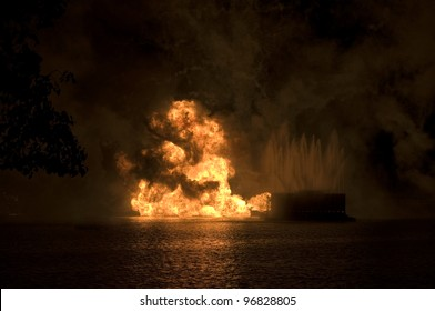 Gas fire explosion on water at night