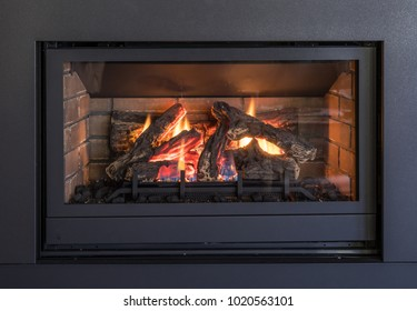 Gas Fireplace, Logs and Flames in Black Metal Frame