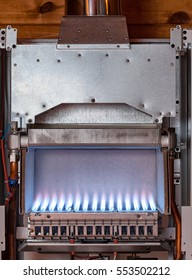 Gas flame inside of the gas boiler furnace