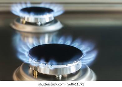 Gas flame of a gas stove in stainless steel./Gas flame of a gas stove