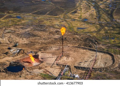 Gas flaring at an oil field in the Russian tundra
