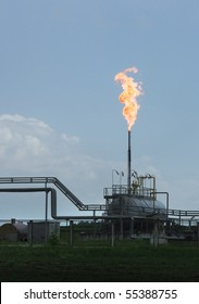 Gas flaring at a refinery. Burning gas flare on the tower - the industry on natural gas production.