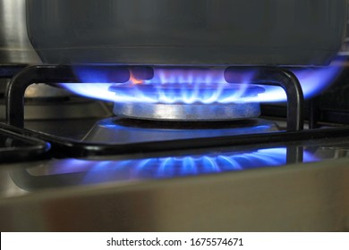 A Gas Hob Burner Used To Heat Up A Saucepan. Selective Focus.