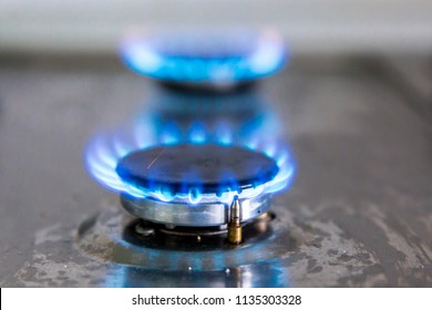 Gas hobs on the stove. Burning blue gas. Gas burners