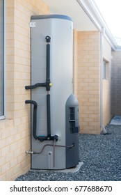 Gas hot water system outside of a modern Australian house
