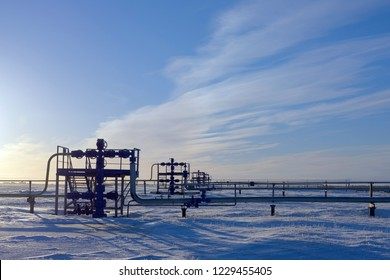 Gas industry. Group wellheads and fittings, High pressure gas well. Snow tundra