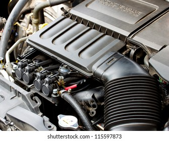 gas injector installed in gasoline engine to use cheaper alternative fuel