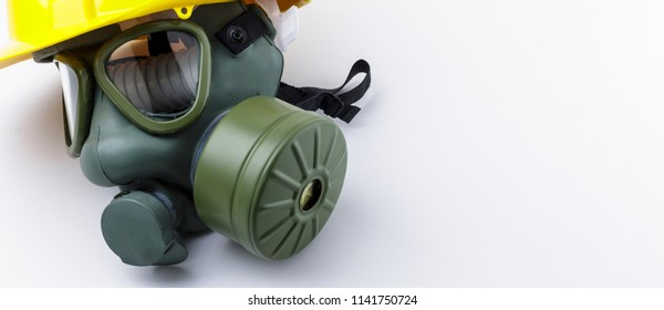 Gas mask with hard hat on a white background banner image with copy space