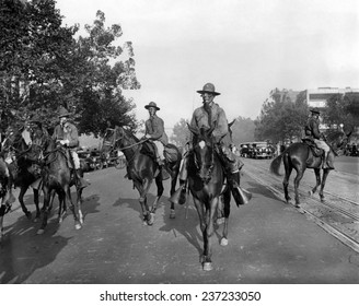 Gas Masked cavalry on Pennsylvania Avenue reinforce Washington DC police July 28, 1932. Bonus Army veterans resisted police evictions from their shanty town on Anacostia Flats.