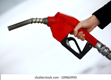 Gas nozzle in woman's hand