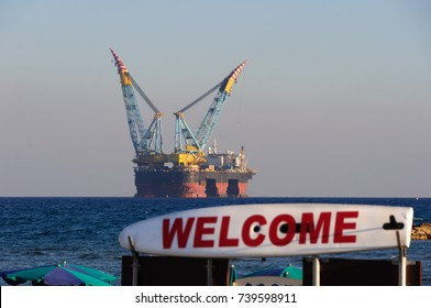Gas and oil rig in Cyprus. Offshore exploration platform near beach. Back focus