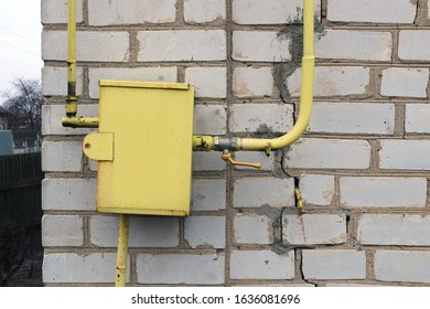 The gas pipe and gas equipment are fixed on the wall of the house. Gas supply. - Shutterstock ID 1636081696