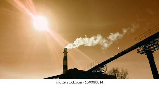 the gas pipe of the plant pollutes the environment under the scorching sun, so the sky is brown