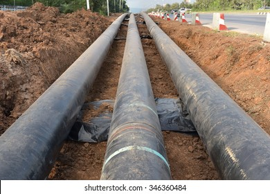 gas pipes and working excavator