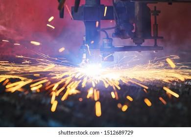 Gas plasma cutting. Metal machining with sparks on CNC maching