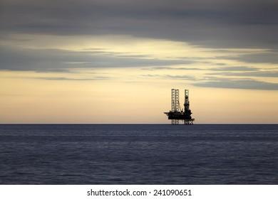 Gas platform at sunset