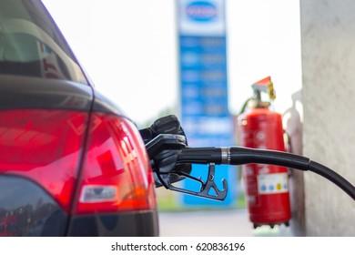 gas pump nozzle in a car