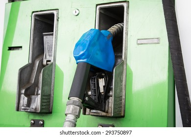 Gas pump nozzles in service station