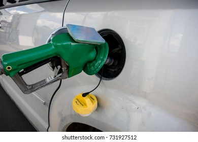 the gas pump is in the gas tank of the car