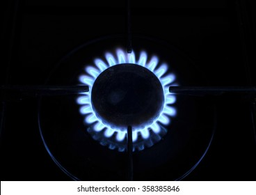 Gas ring flame on kitchen oven hob.