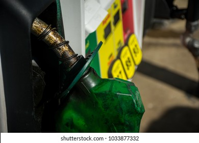 At the Gas station. Filling up gasoline at the gas pump. 87 octane , 89 octane , or 93 octane. Dirty corrosion on gas pump handle
