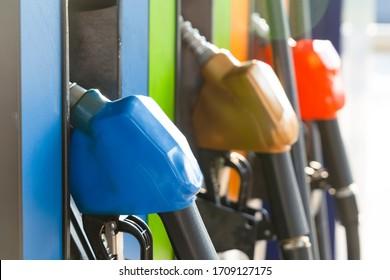 Gas station Fuel pump.Colorful Petrol pump filling nozzles in gas petrol filling station.