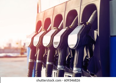 Gas station. Gas station in the mountains. Guns for refueling at a gas station on a sunset day in the summer in the mountains. Car pulls up to refuel. Service