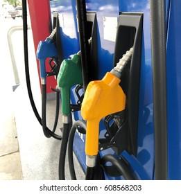 Gas station, petrol station, fuel nozzle