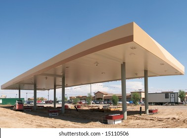 Gas station under construction near new shopping mall.