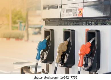 Gas stations are colorful, fill different nozzles. Gas stations adjust the oil prices down a lot.