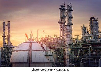 Gas storage sphere tank in oil refinery industry on sky sunset background