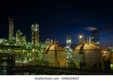 Gas storage sphere tanks in industrial plant with night, Glitter lighting of oil and gas refinery plant, Petrochemical industry