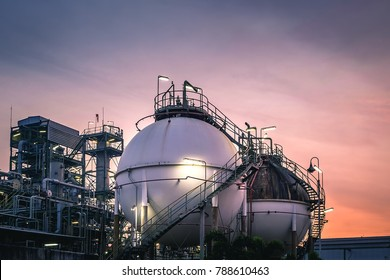Gas storage sphere tanks in oil and gas refinery plant with sunset sky background