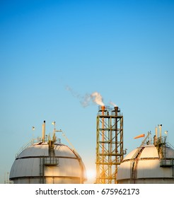 Gas storage spheres tank in oil refinery plant and chimney background with blue sky