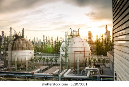 Gas storage spheres tank in petrochemical plant at sunrise