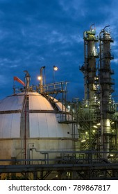 Gas storage spheres tank in refinery plant at twilight column tower background