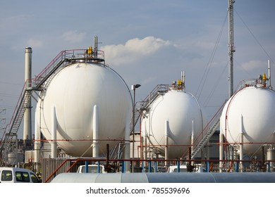 Gas storage tanks in a large refinery.