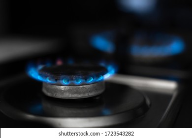 Gas stove, gas is burning. Gas burner on a dark background.