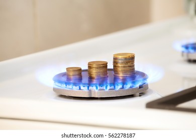 Gas stove with money in flame.  Concept image of rising tariff