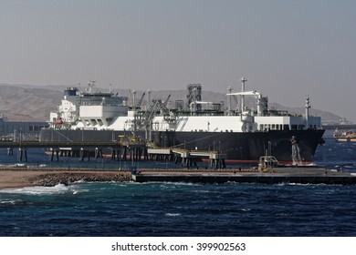 Gas tanker loading in port