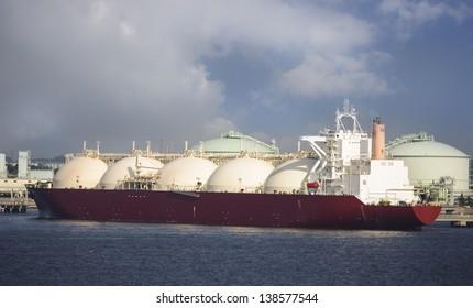 Gas tanker loading in port, Japan