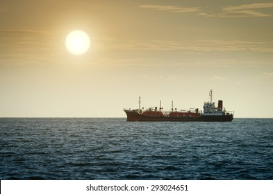 Gas tanker in the sea at sunset