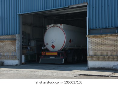 Gas truck or tank truck is parked in the small gas storage facility. It will be unloading the gas to a underground storage.