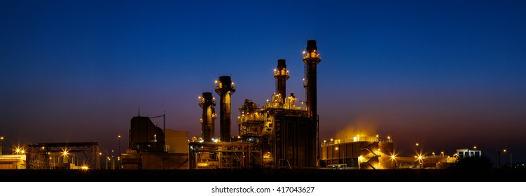 Gas turbine electrical power plant at dusk with light , panorama view