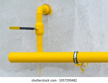 Gas yellow pipe. Gas pipeline on a residential house with a latch.
