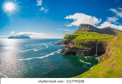 Gasadalur village and Beautiful  waterfall, Sunny Day, Vagar, Faroe Islands, Denmark.