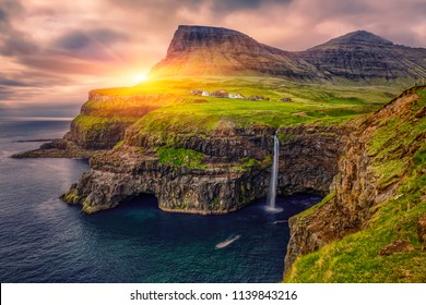 Gasadalur village and Beautiful  waterfall, At Sunset, Vagar, Faroe Islands, Denmark.